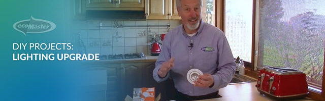 ecoMaster Maurie Beinat holding an LED downlight