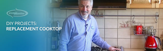 ecoMaster Maurice Beinat placing his hand on their induction cooktop