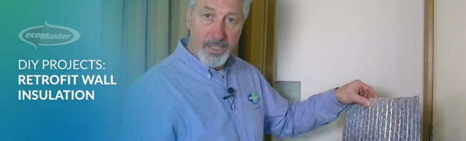 ecoMaster Maurice Beinat holding a Retroshield reflective wall insulation