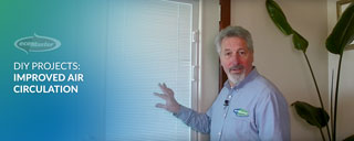 ecoMaster Maurice Beinat standing in front of a double glazed door with installed blinds