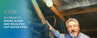 ecoMaster Maurice Beinat showing their smoke alarm and insulated hot water pipes in their ceiling